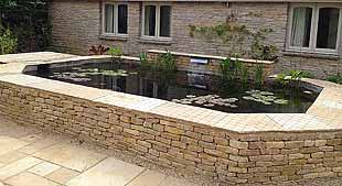 Cotswold raised koi pool with stainless cascade (© aquapic)